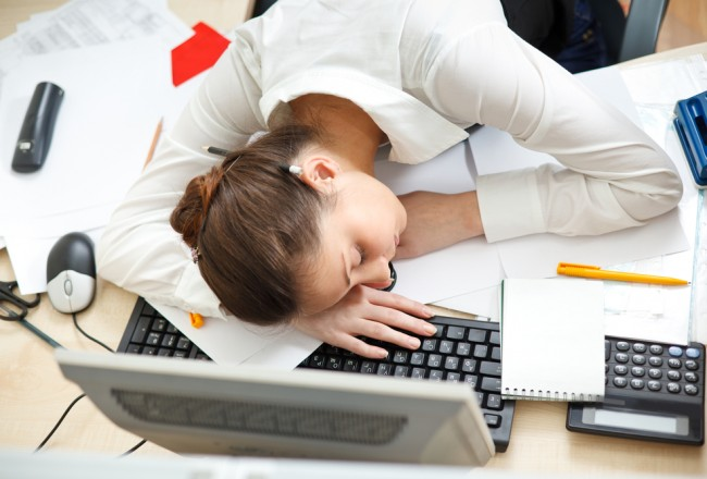 young-woman-falling-asleep-at-her-desk